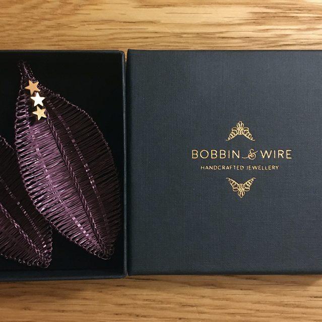 Bobbin & Wire logo in gold foil